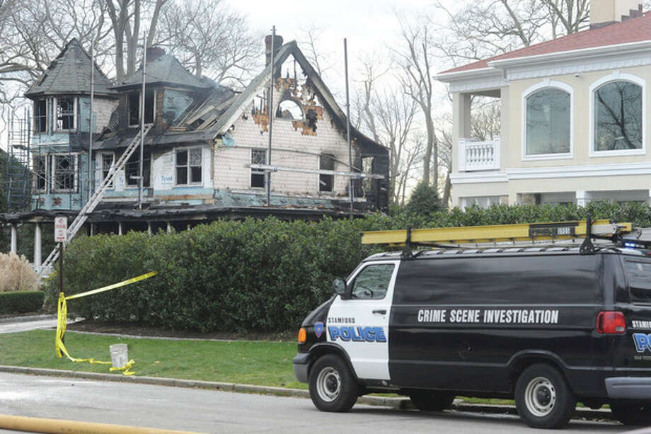 Stamford police outside of a home at 2267 Shippan Avenue in Stamford on Christmas Day 2011. Five died in the blaze. File photo/Matthew Vinci / (C)2011, The Hour Newspapers, all rights reserved