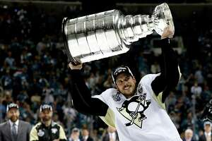 SAN JOSE, CA - JUNE 12:  Sidney Crosby #87 of the Pittsburgh Penguins celebrates by hoisting the Stanley Cup after their 3-1 victory to win the Stanley Cup against the San Jose Sharks in Game Six of the 2016 NHL Stanley Cup Final at SAP Center on June 12, 2016 in San Jose, California.