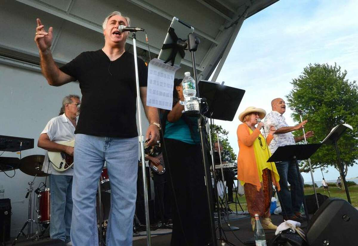 Hour Photo/Alex von Kleydorff Tim Currie's Motown Band performs at Calf pasture along with the Coachmans Beach Cruise on Wednesday night