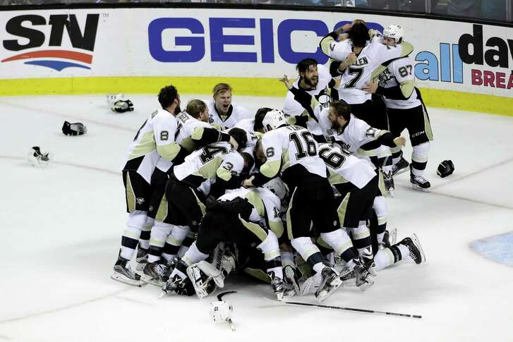 SAN JOSE, CA - JUNE 12:  The Pittsburgh Penguins celebrate after their 3-1 victory to win the Stanley Cup against the San Jose Sharks in Game Six of the 2016 NHL Stanley Cup Final at SAP Center on June 12, 2016 in San Jose, California.  (Photo by Ezra Shaw/Getty Images)