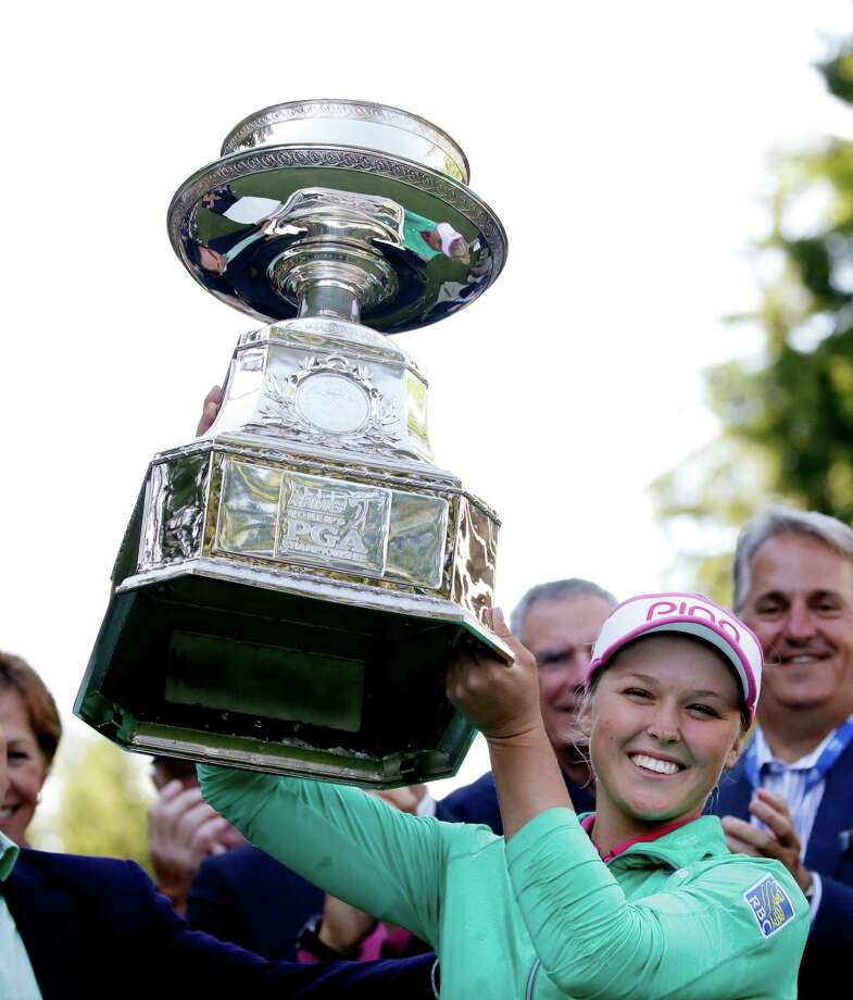 Brooke Henderson, of Canada, lifts the championship trophy after winning the Women's PGA Championship golf tournament at Sahalee Country Club on Sunday, June 12, 2016, in Sammamish, Wash. (AP Photo/Elaine Thompson) ORG XMIT: WAET115 Photo: Elaine Thompson / Copyright 2016 The Associated Press. All rights reserved. This m