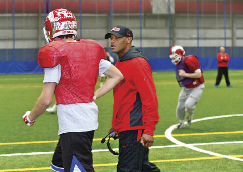 Hour photo/Erik TrautmannDac Newton, a Norwalk native and former football player at Brien McMahon and UConn, is now an assistant coach at New Canaan, which is playing for state title on Saturday.