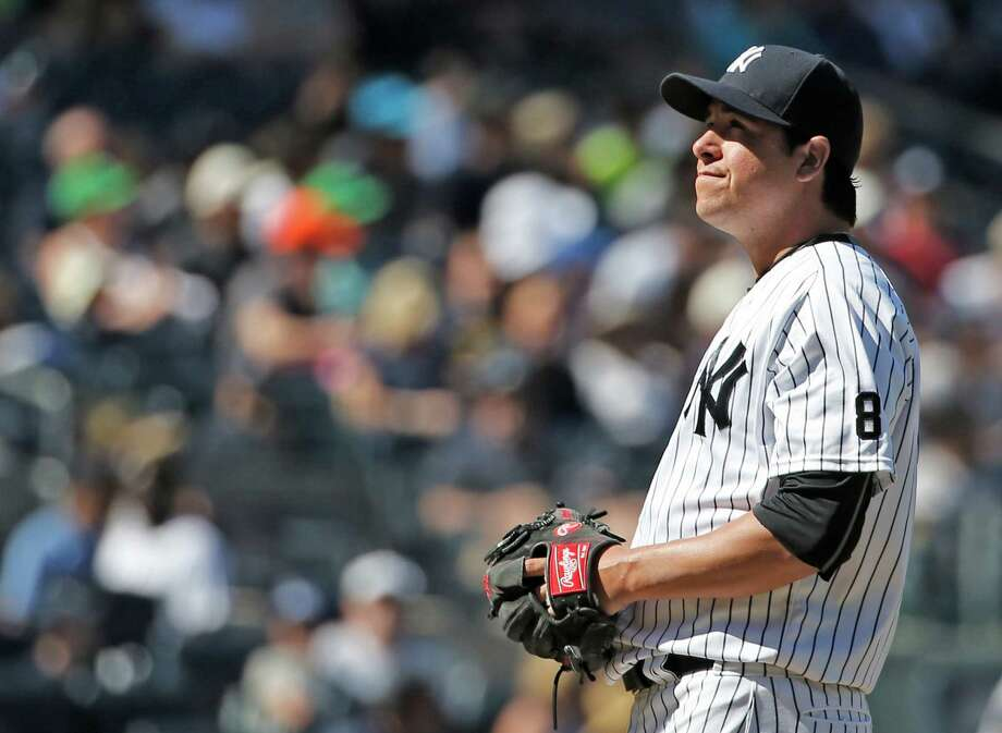 New York Yankees relief pitcher Anthony Swarzak (43) reacts after allowing a two-run home run to Detroit Tigers Ian Kinsler during the seventh inning of a baseball game, Sunday, June 12, 2016, in New York. (AP Photo/Kathy Willens) ORG XMIT: NYY120 Photo: Kathy Willens / Copyright 2016 The Associated Press. All rights reserved. This m