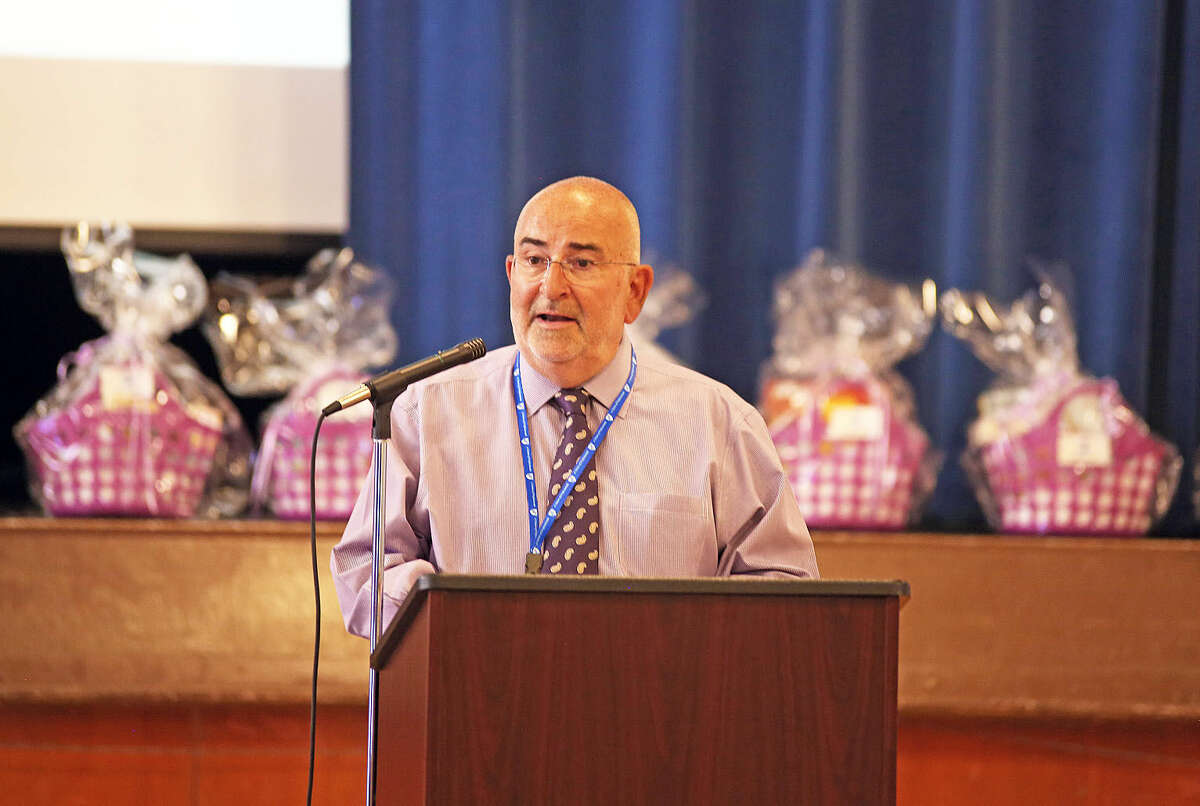 Bruce LeVine Mellion, President of Norwalk Federation of Teachers, kicks off Norwalk Public School's second module of Literacy 4 Parents 4 Their Children, a program created by three Norwalk teachers that teaches parents how to improve literacy skills at home, at Brookside Elementary School Friday evening. Hour Photo / Danielle Calloway