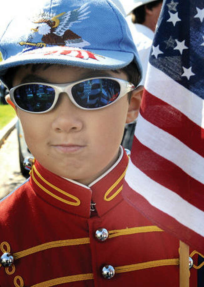 Chris Rickard, 7, marches in the 2014 Columbus Day Parade in Stamford with the Norwalk Nash Drum Corps.
