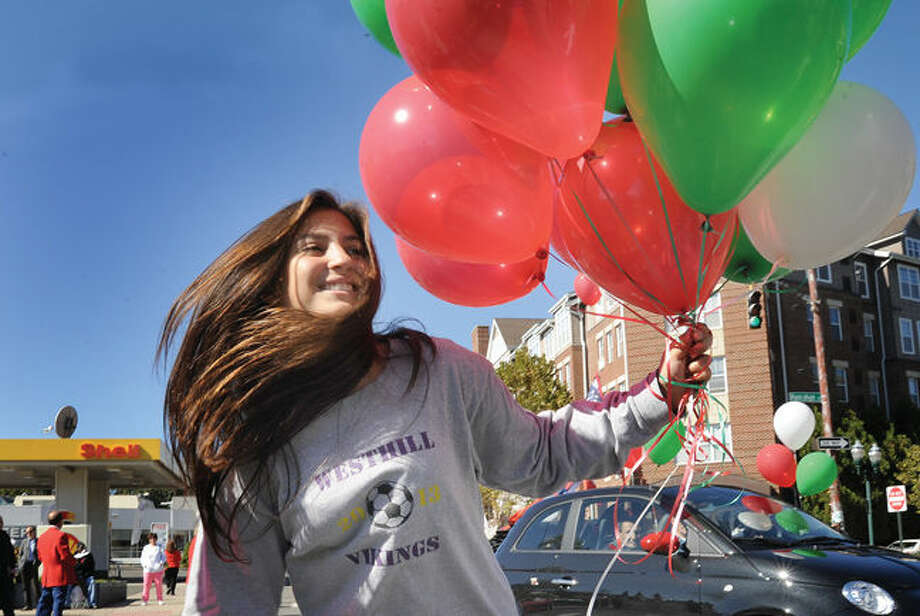 Maria Elizathe with the Westhill High School Italian Club marches in the 2014 Columbus Day Parade in Stamford.