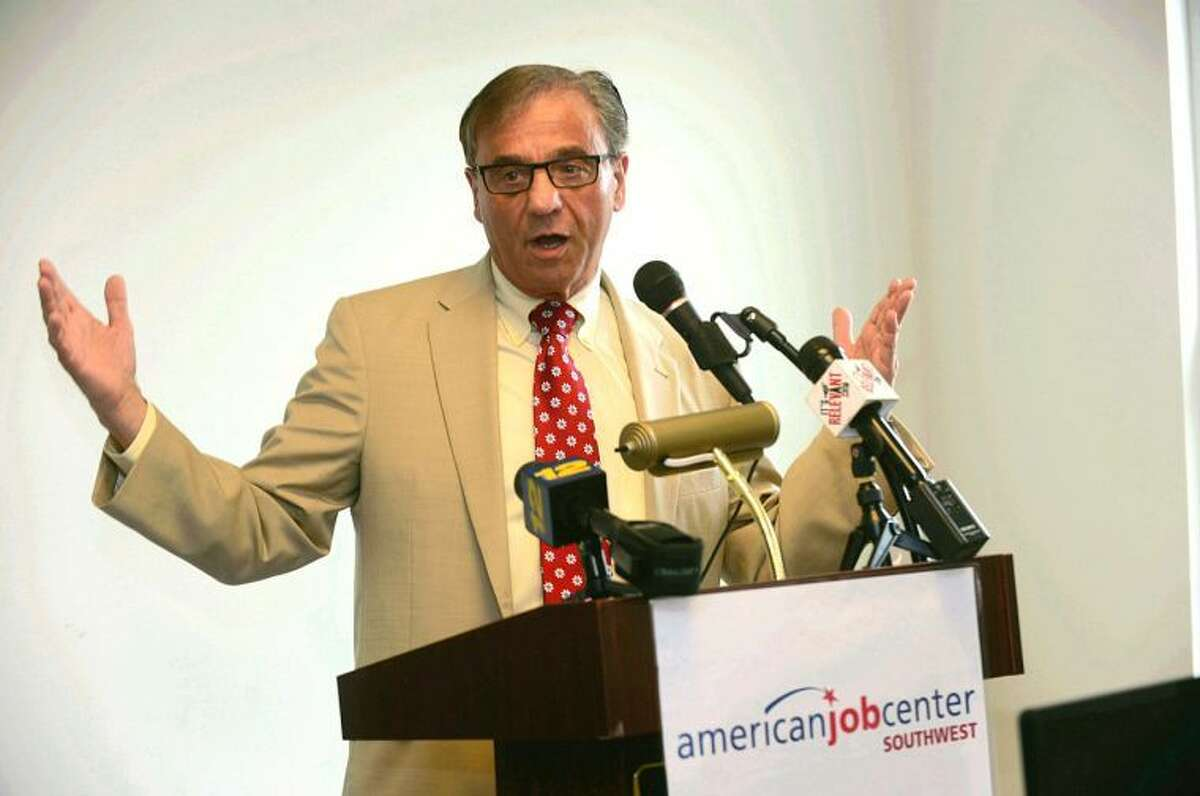 Joe Carbone, president of The Workplace, speaks during a press conference announcing the opening of the American Jobs Center Wednesday.