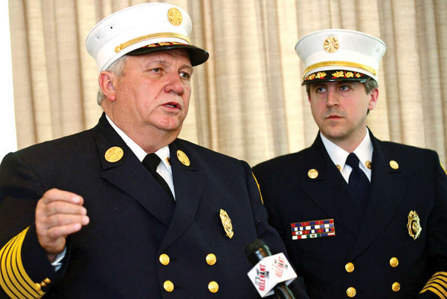 Hour photo / Erik Trautmann Stamford Fire Chief Peter Brown and Turn Of River (TOR) Chief Frank Jacobellis comment on the signing of an agreement to consolidate the City and Turn of River Volunteer Fire Departments during a press conference Wednesday.