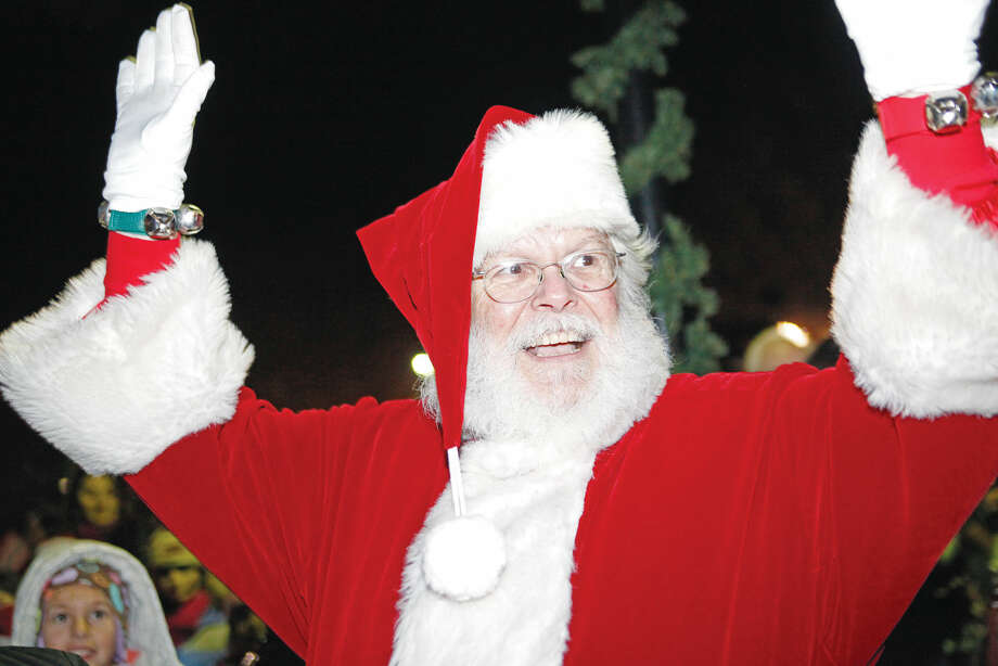 Santa Claus arrives during the annual Wilton tree lighting and Holiday Stroll in these file photos from 2011.