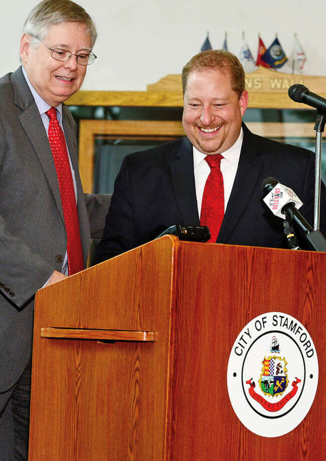 Mayor David Martin, left, announces the appointment of permanent Economic Development Director, Thomas Madden, during a press conference at the Government Center Thursday. The announcement will be Martin's final senior level appointment since taking office.