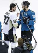 San Jose Sharks' Logan Couture shakes hands with Pittsburgh Penguins' Sidney Crosby after Penguins' 3-1 win in Game 6 of  the Stanley Cup Final at SAP Center in San Jose, Calif., on Sunday, June 12, 2016.