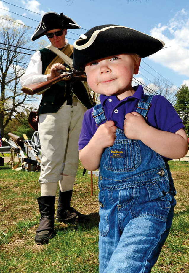 Eric Fleming, 2, tries on a tri-corner hat during the Wilton Historical Society Barn Raising Day Saturday in Wilton.