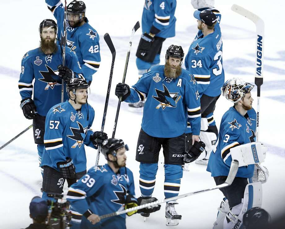 Clockwise from top, Brenden Dillon, James Reimer, Joe Thornton, Martin Jones, Logan Couture, Tommy Wingels, Brent Burns and Joel Ward salute Sharks fans after losing Game 6 of the Stanley Cup Finals. Photo: Scott Strazzante, The Chronicle