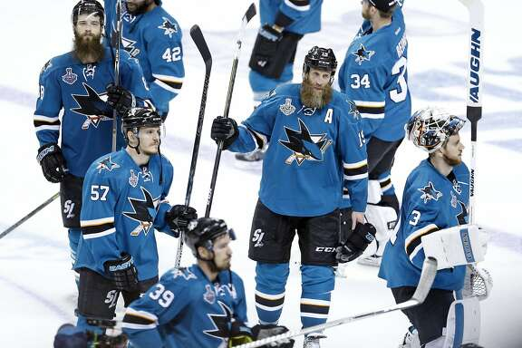 San Jose Sharks' Joe Thronton (19), Brent Burns (88), Martin Jones (31), Tommy Wingels (57) and Logan Couture (39) salute the fans after their 3-1 loss to Pittsburgh Penguins in Game 6 of  the Stanley Cup Final at SAP Center in San Jose, Calif., on Sunday, June 12, 2016.