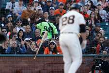 SAN FRANCISCO, CA - JUNE 12: The bat of Buster Posey #28 of the San Francisco Giants is stuck in the net behind home plate after it slipped from Posey's hands while at bat in the second inning against the Los Angeles Dodgers at AT&T Park on June 12, 2016 in San Francisco, California. (Photo by Lachlan Cunningham/Getty Images)