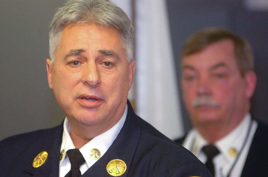 Former Fire Chief Antonio Conte speaks during a press conference about the fatal Christmas Day fire on Shippan Avenue. / 2011 The Hour Newspapers