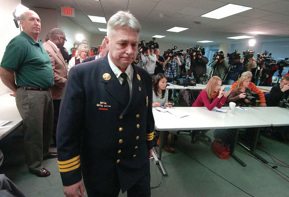 Former Fire Chief Antonio Conte walks up to the podium for a press conference about the fatal Christmas Day fire on Shippan Avenue. / 2011 The Hour Newspapers