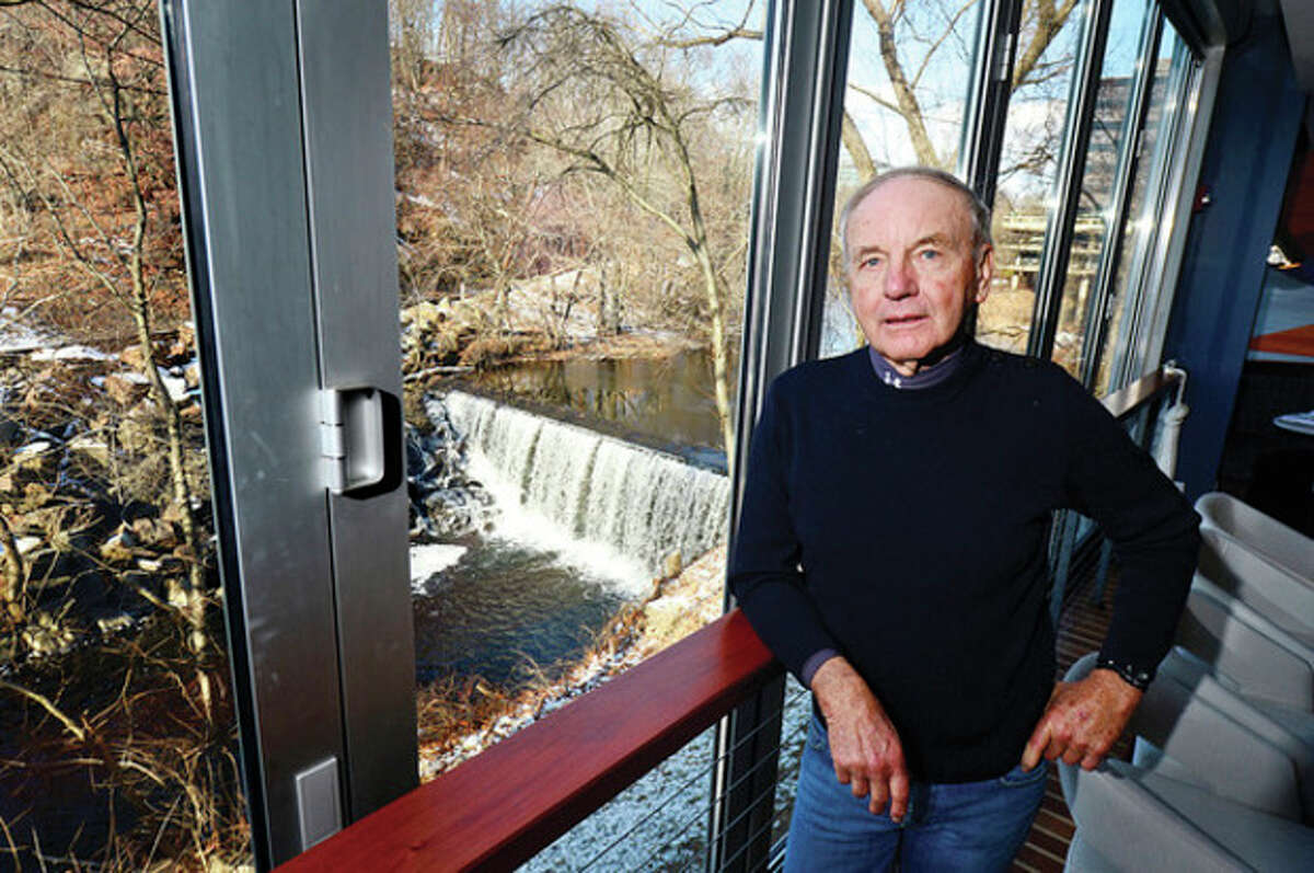 Hour photo / Erik Trautmann Part owner of Hotel Zero Degrees, Bill Burnham, disagrees with the city's plans to remove the picturesque Flock Process Dam on the Norwalk River that sits outside the Hotel's restaurant dining room.