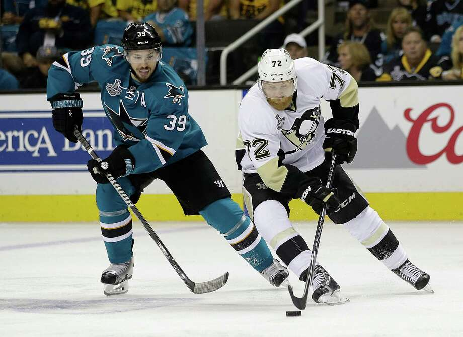 Pittsburgh Penguins right wing Patric Hornqvist (72), from Sweden, skates in front of San Jose Sharks center Logan Couture (39) during the first period of Game 6 of the NHL hockey Stanley Cup Finals in San Jose, Calif., Sunday, June 12, 2016. (AP Photo/Marcio Jose Sanchez) ORG XMIT: SJA110 Photo: Marcio Jose Sanchez / AP