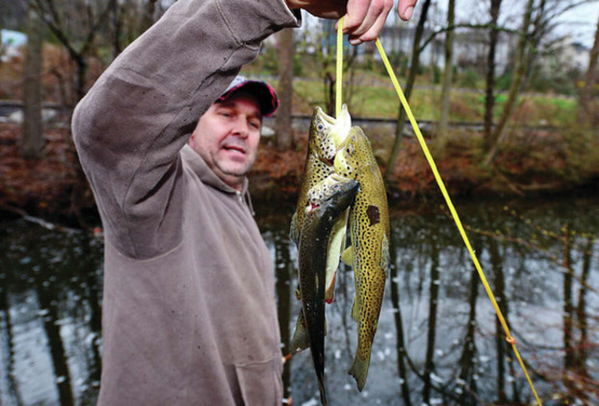John Fairchild of Wilton fishes for trout on the Norwalk River in Wilton.