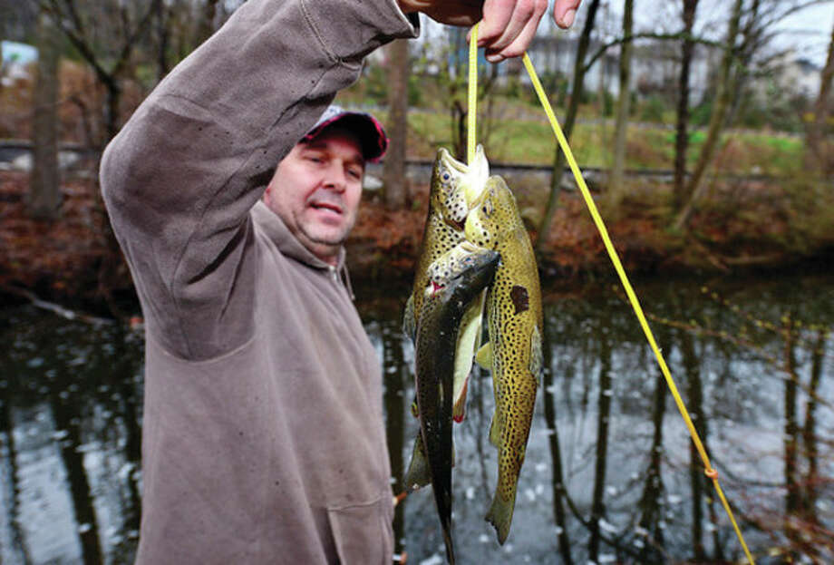John Fairchild of Wilton fishes for trout on the Norwalk River in Wilton. / (C)2013, The Hour Newspapers, all rights reserved