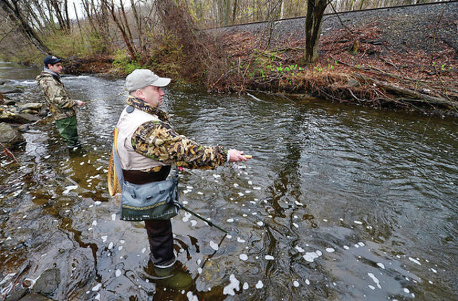 Lou Martines and Matt Seymour fish for trout on the Norwalk River in Wilton. / (C)2013, The Hour Newspapers, all rights reserved