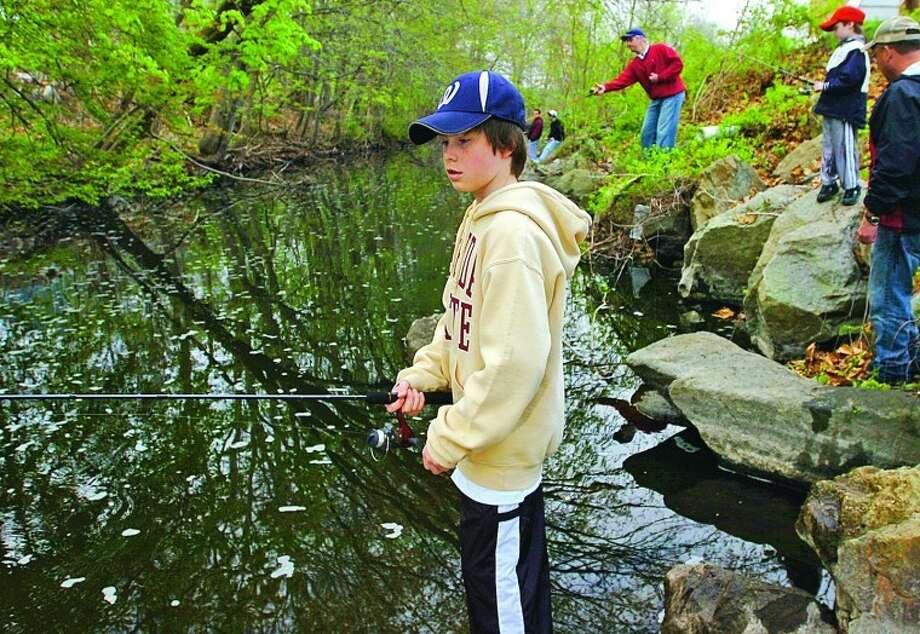 Zach LIston, 11 fishes on the Norwalk River in Wilton on opening day of trout season Saturday. Hour photo / Erik Trautmann