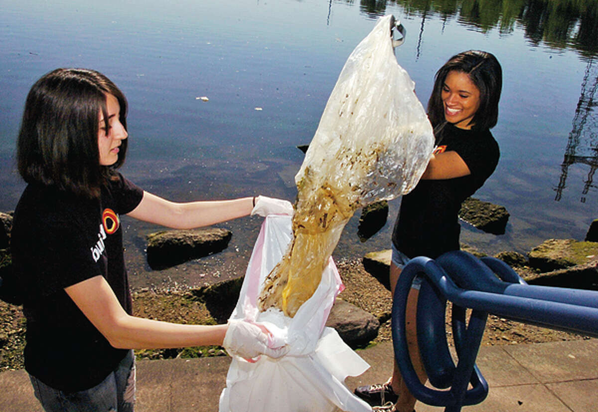Build On community service members Lisa Bucceieri and Aleeyah Chesney help with the Norwalk River Watershed Association and Norwalk Land Trust Clean Up at Heritage Park Saturday. Hour photo / Erik Trautmann