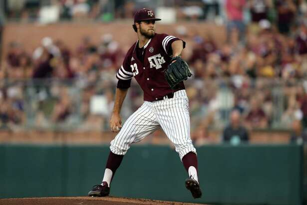 Texas A&M's Turner Larkins (23) throws to home against TCU during the first inning of a NCAA college baseball Super Regional tournament game, Sunday, June 12, 2016, in College Station, Texas. (AP Photo/Sam Craft)