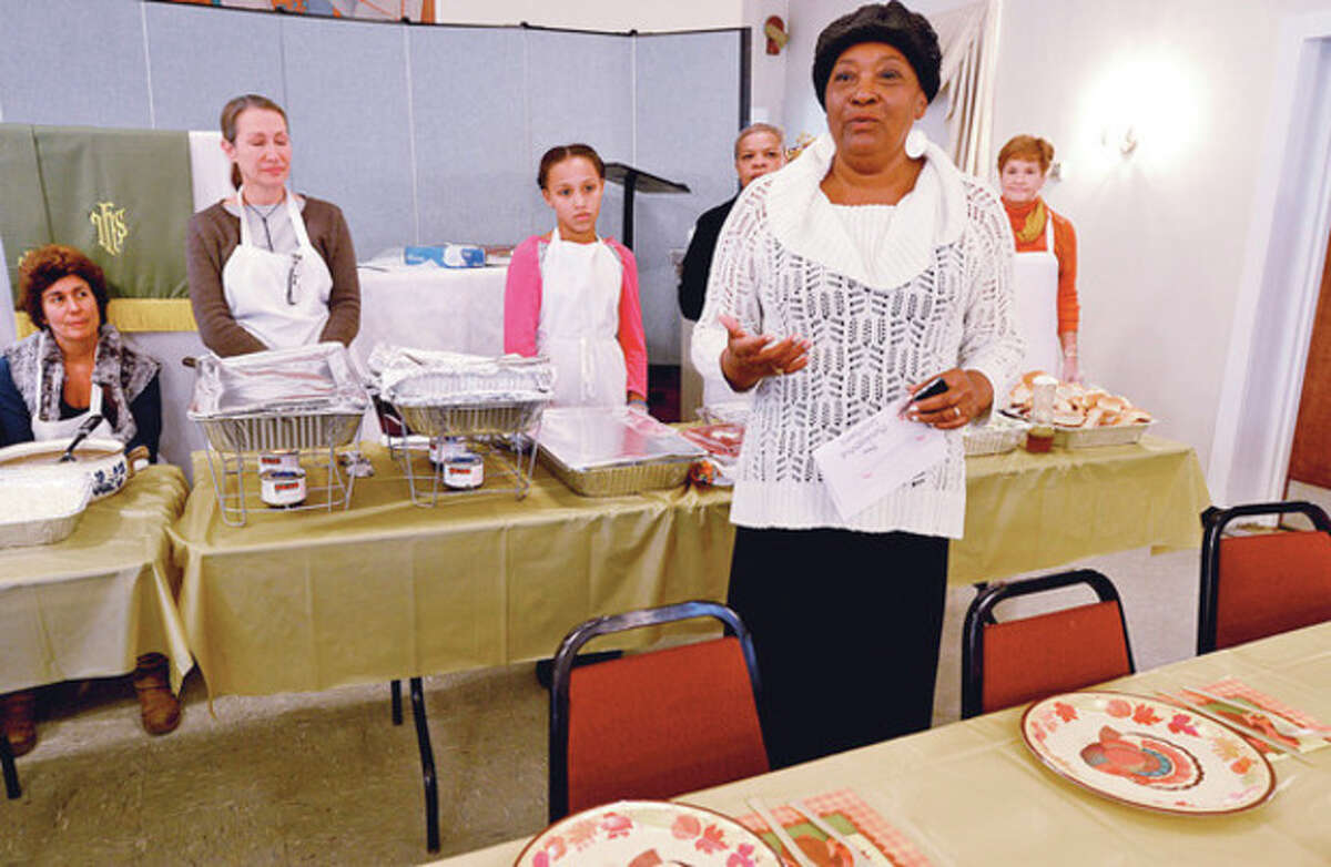 Nellie Mann speaks at the annual Heart-to-Heart Foundation Thankgiving Feast Satuday at Calvary Baptist Church. Heart-to-Heart is a nonprofit formed by the Rev. Nellie Mann to help the needy. Hour photo / Erik Trautmann