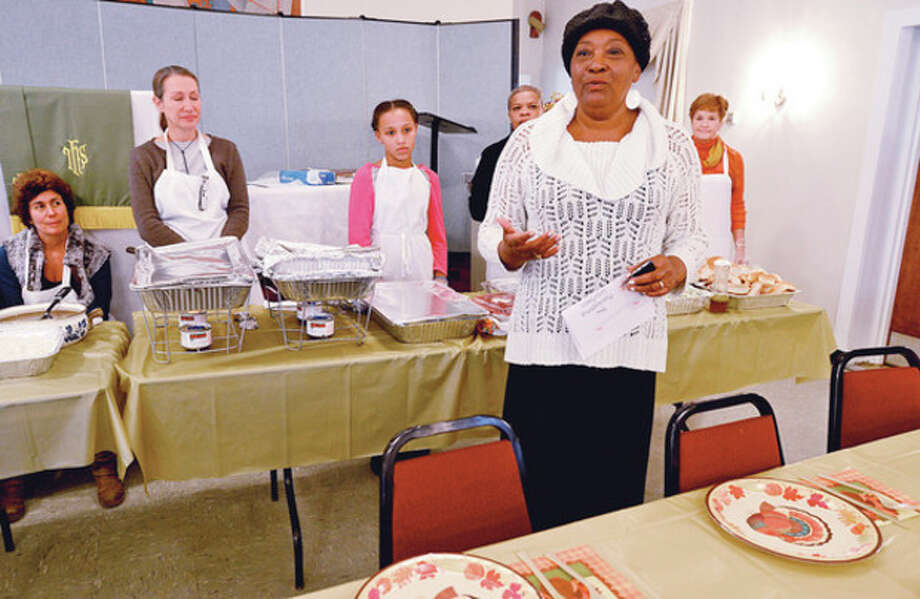 Nellie Mann speaks at the annual Heart-to-Heart Foundation Thankgiving Feast Satuday at Calvary Baptist Church. Heart-to-Heart is a nonprofit formed by the Rev. Nellie Mann to help the needy.Hour photo / Erik Trautmann / (C)2012, The Hour Newspapers, all rights reserved