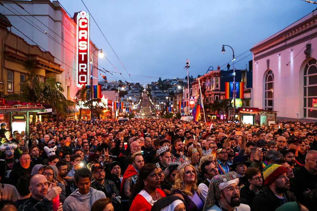Hundreds of people gather during a vigil to honor the victims of the Orlando massacre, in San Francisco, California, on Sunday, June 12, 2016.