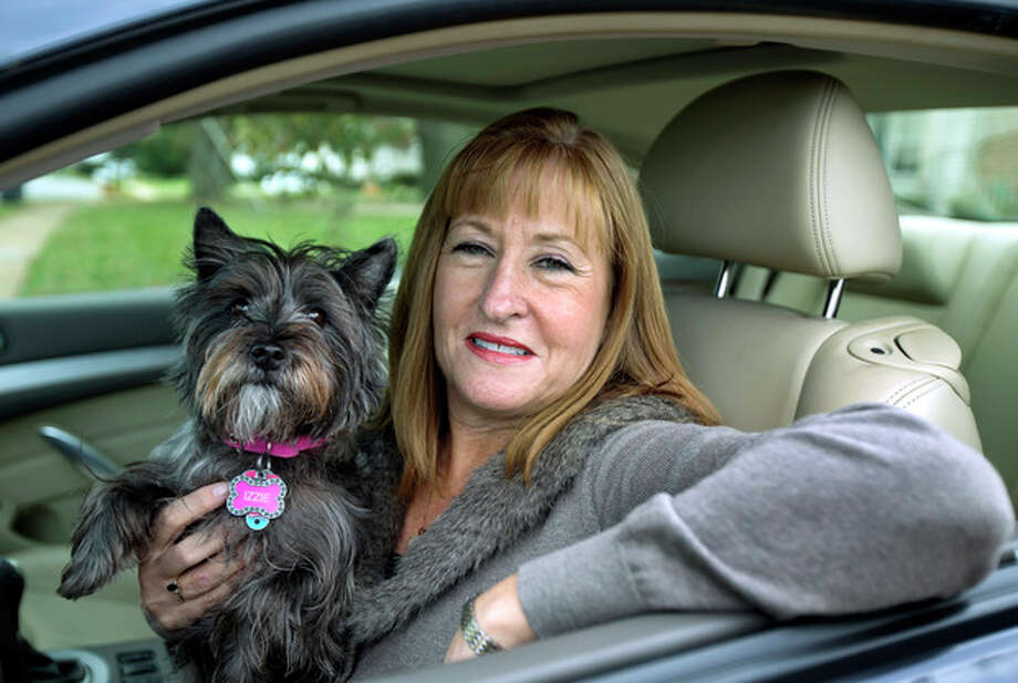 "This Nov. 2, 2012 file photo shows Diane Spitaliere and her pet dog Izzie sitting in her car outside her house in Alexandria, Va. Women have passed men on the nation's roads. More women now have driver's licenses than men, a reversal of a longtime gender gap behind the wheel that transportation researchers say is likely to have significant safety and economic implications. Spitaliere, 58, a retired government worker says: ""I want to be in my own car for as long as possible. I want to be independent for as long as I can."" (AP Photo/Manuel Balce Ceneta, File) / AP"