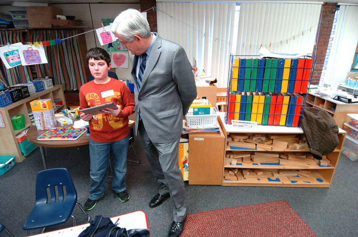 Wilton Superintendent of Schools Dr. Gary Richards talks with Cider Mill School fifth-grader Harry Coleman, 10, about how he is able to use new Nearpod App as an instructional aid at TechExpo.