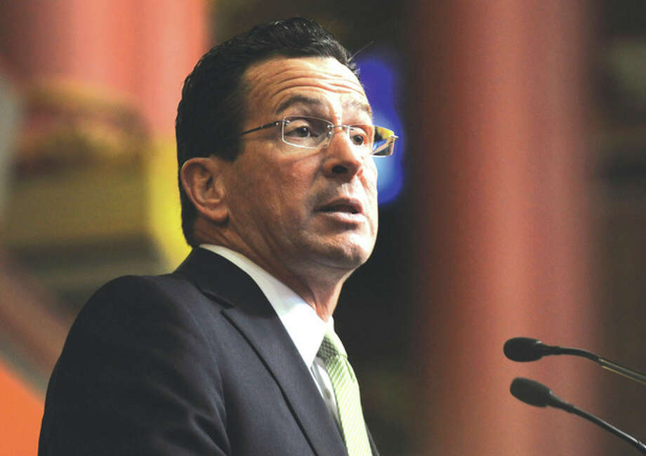 Connecticut Gov. Dannel P. Malloy presents his first two-year budget, during a joint session of the General Assembly at the Capitol, in Hartford, Conn., Wednesday, Feb. 16, 2011. The plan raises taxes across-the-board, seeks $2 billion in savings from state employees and attempts to cut spending without stripping programs for the needy. (AP Photo/Jessica Hill) / AP2011