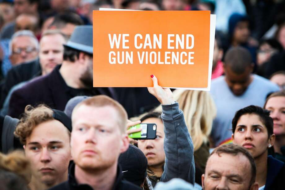 A woman holds up a sign against gun violence, during a vigil to commemorate victims of the Orlando massacre, in San Francisco, California, on Sunday, June 12, 2016. Photo: Gabrielle Lurie, Special To The Chronicle