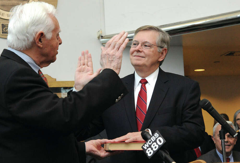 Hour photo / Matthew VinciDavid Martin takes the oath of office from his father, Judge Gene Martin, on Dec. 2, 2013 during a ceremony at the Stamford Government Center that was attended by hundreds of his friends and supporters.