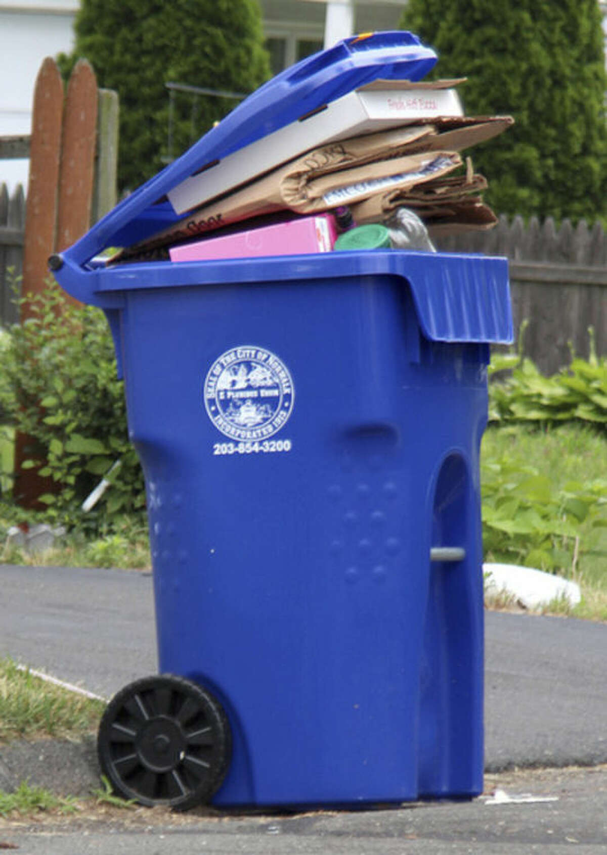 Hour photo / Chris Bosak One of the new large single-stream recycling bins in Norwalk.