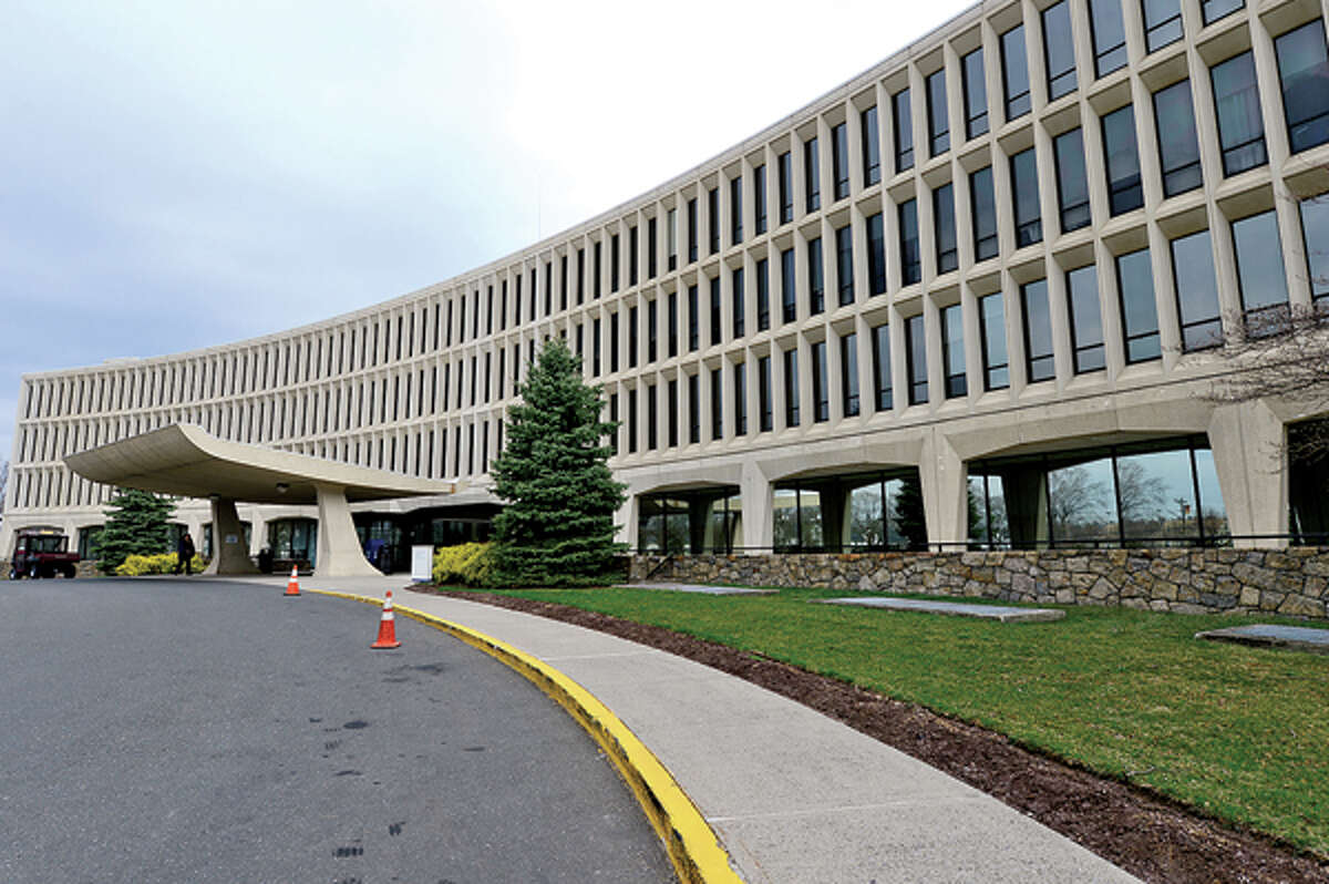 The Stamford hospital main building. The entrance, valet parking and visitor parking for the Whittingham Pavillion and the Bennett Cancer Center will be relocated to the southside of the campus to make room for construction on a new main building to begin next week.Hour photo / Erik Trautmann