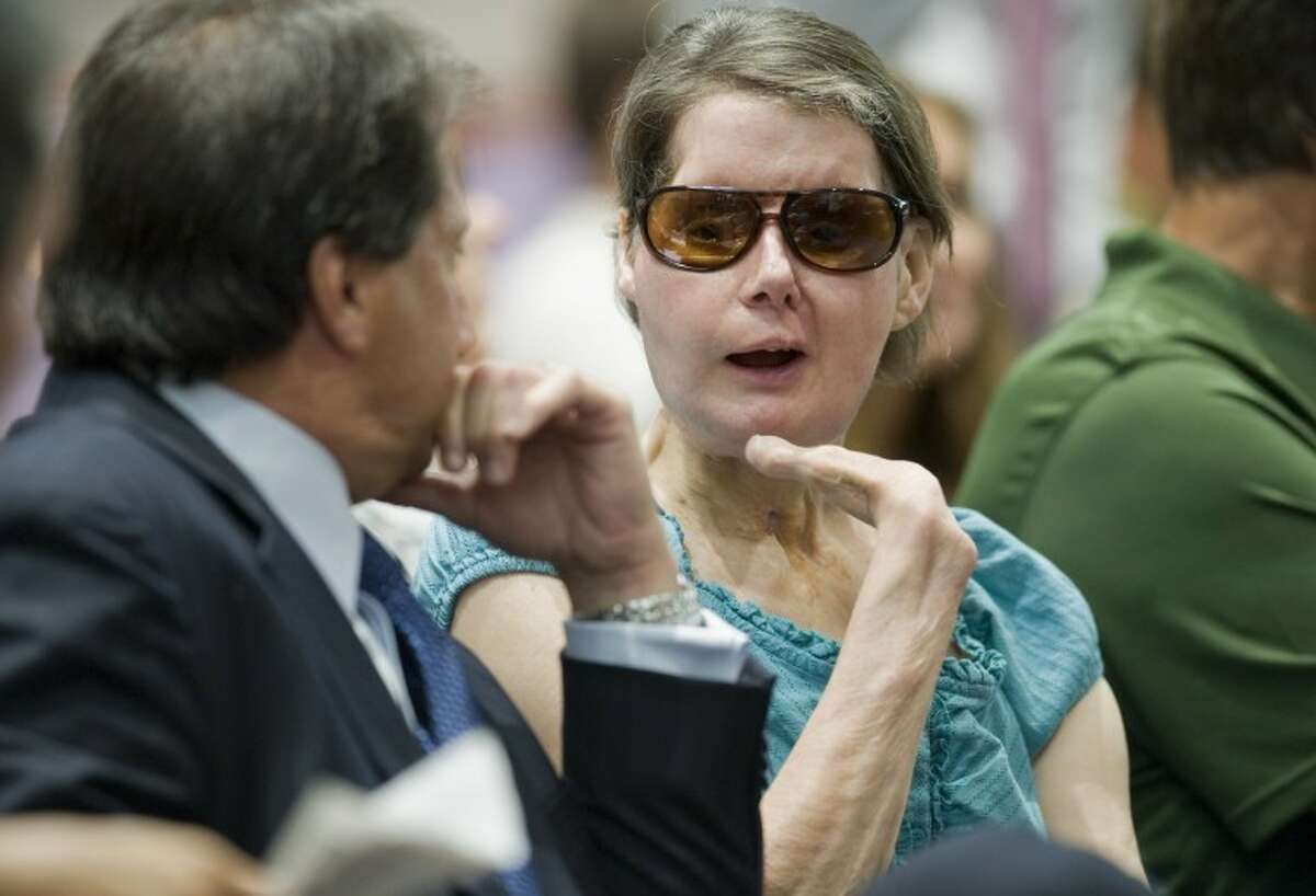 Charla Nash, right, talks with attorney Bill Monaco before a hearing at the Legislative Office Building in Hartford, Conn., Friday, Aug. 10, 2012. Nash who was mauled in a 2009 chimpanzee attack is attending a hearing to determine whether she may sue the state for $150 million in claimed damages. (AP Photo/Jessica Hill)