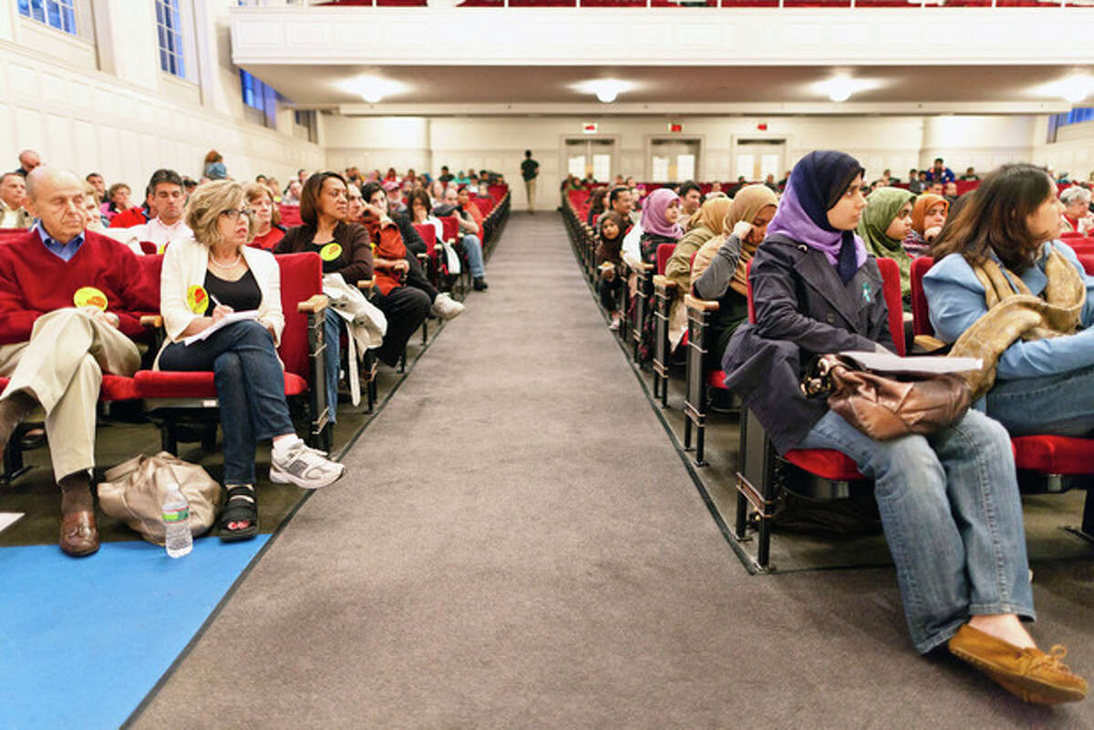 A room divided. On the Left Members of the community against the building of the mosque and those in support of the mosque on the right during a public meeting Wednesday evening at Norwalk City Hall. DAVID ESPOSITO / Hour photo