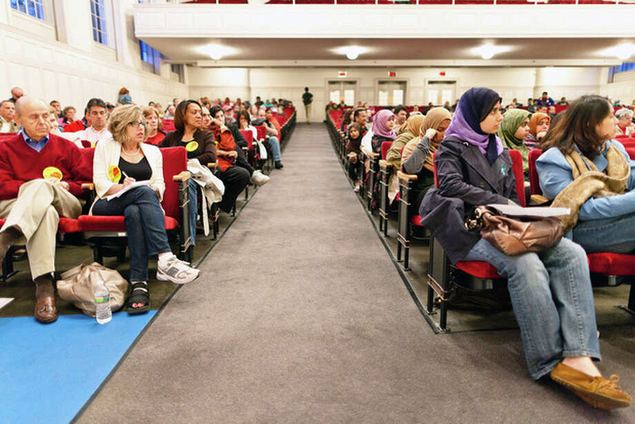 A room divided. On the Left Members of the community against the building of the mosque and those in support of the mosque on the right during a public meeting Wednesday evening at Norwalk City Hall. DAVID ESPOSITO / Hour photo / LUCIO Photography