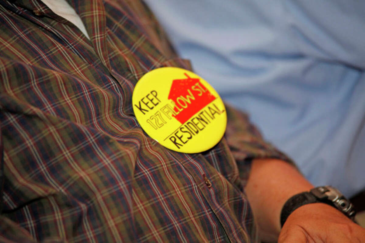 Pins were worn by those against the Al-Madany Islamic Center of Norwalk's plan for 27,000-square-foot mosque/community center at 127 Fillow St during a meeting in which the application was denied inside City Hall Wednesday afternoon. Hour Photo / Danielle Robinson