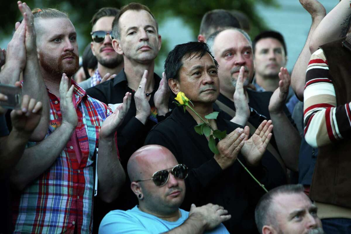 Scenes from a vigil at Cal Anderson Park in Capitol Hill for the victims of a mass shooting at Pulse nightclub in Orlando, which killed 49 people and left 53 more injured, Sunday, June 12, 2016.