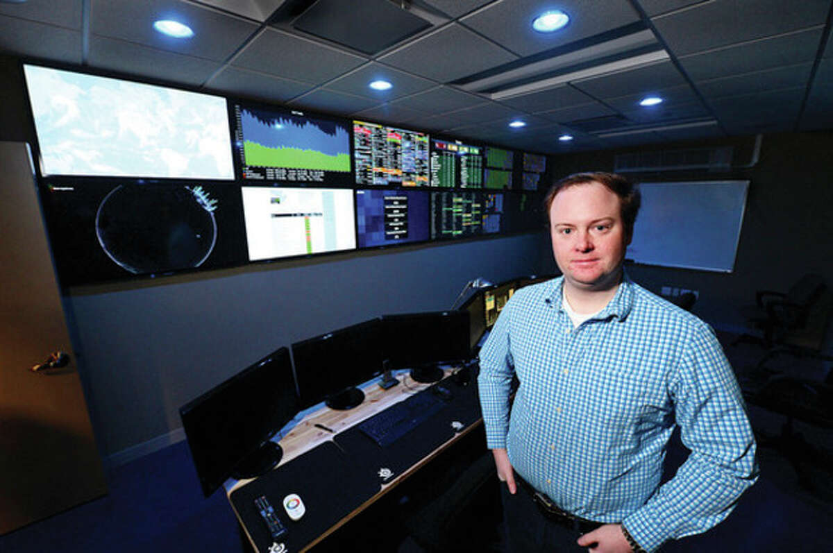 Hour photo / Erik Trautmann Datto CEO and founder Austin McChord in his quickly expanding business's control room in the Merritt 7 Corporate Park in Norwalk.
