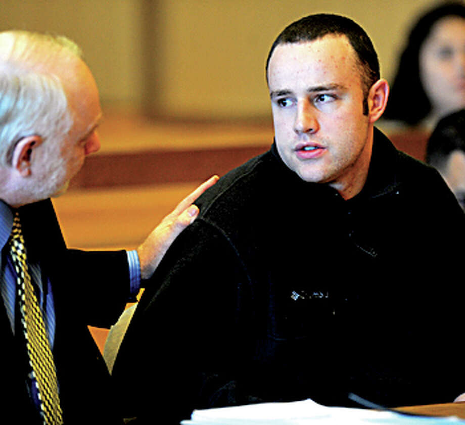 Aaron Ramsey of Wilton, right, sits beside his lawyer, Howard Ehring, left, as Ramsey is found not guilty by reason of mental disease or deficiency by a three-judge panel during a verdict reading at state Superior Court in Stamford on Wednesday, December 12, 2012. Ramsey was on trial for beating his father, Edward, to death in May after Ramsey allegedly heard voices. / Stamford Advocate