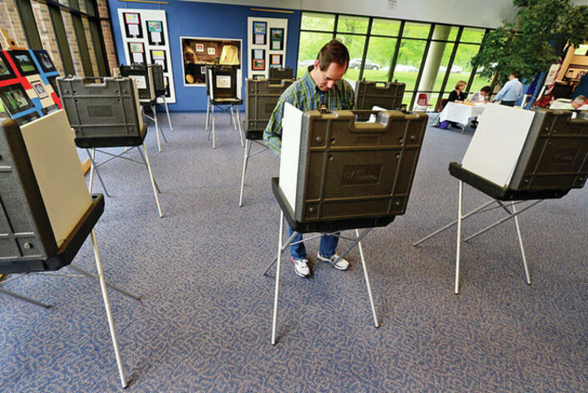 Wilton residents including Jeff Cross vote on the municipal and education budgets as well as capital projects Saturday at Wilton High School. Hour photo / Erik Trautmann