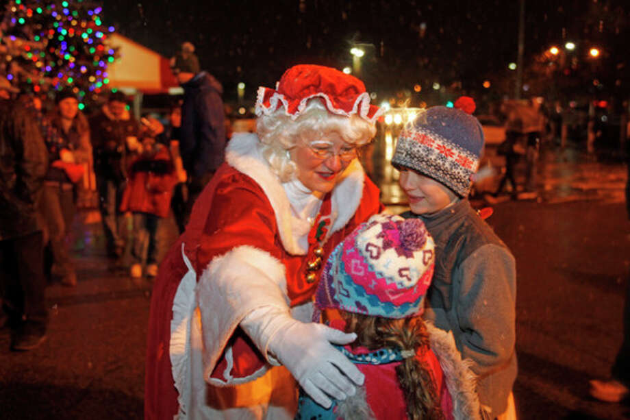In this 2012 file photo, Mrs. Claus gives candy to Keira Gilchrist, 4, and her brother Ryan, 7, during Stew Leonard's annual tree lighting ceremony.Hour Photo / Danielle Robinson