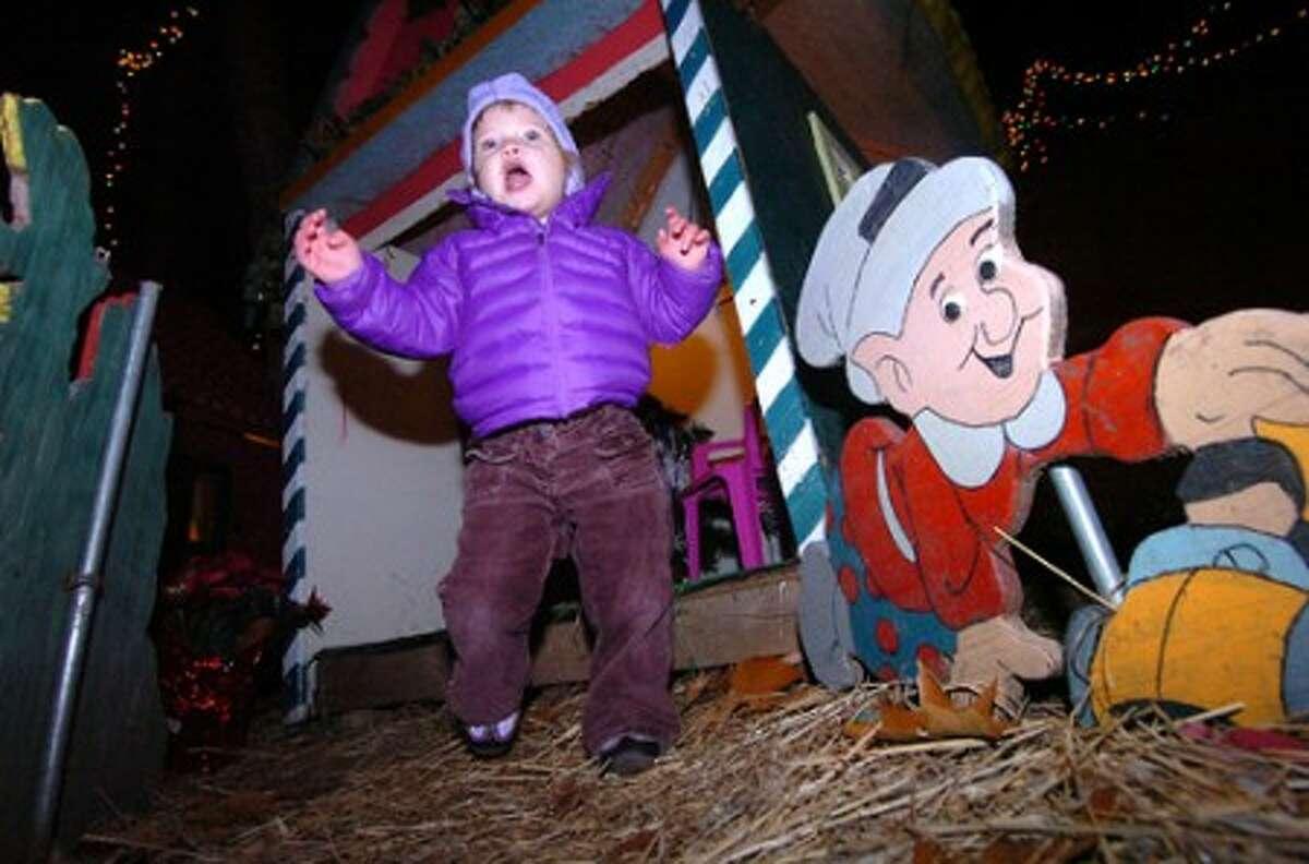 Photo/Alex von Kleydorff. 1.5 yr old Lucy Grabow checks out Santa''s Toy Shoppe at The Setti house on Midwood Norwalk.