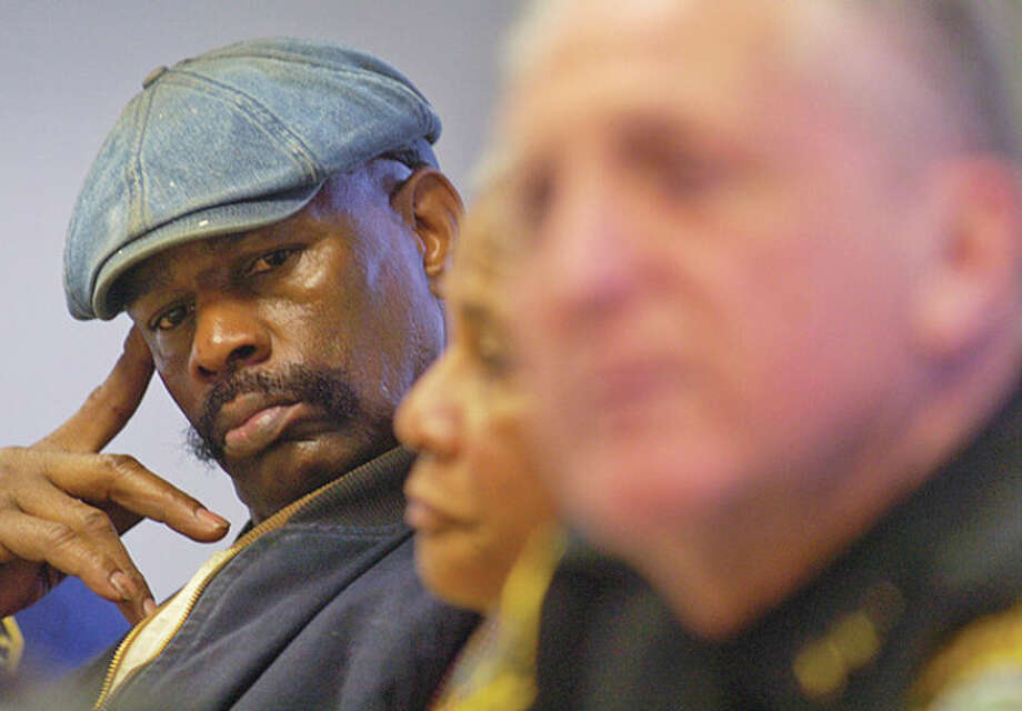 Amos Brown senior, father of Amos Brown Jr who was alain last year, lsitens to Norwalk Police Chief Harry Rilling speak at a press conference Thursday relating to the shooting incident that occurred Tuesday night at Norwalk Hospital. Hour photo / Erik Trautmann / (C)2011, The Hour Newspapers, all rights reserved